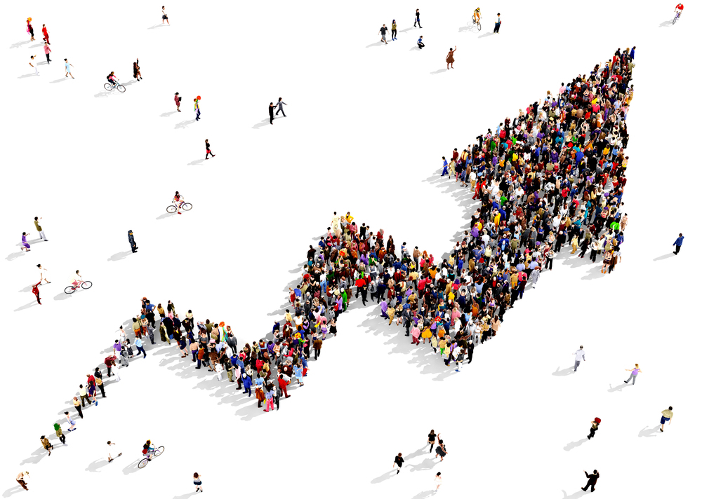 Crowd creating a positive line graph