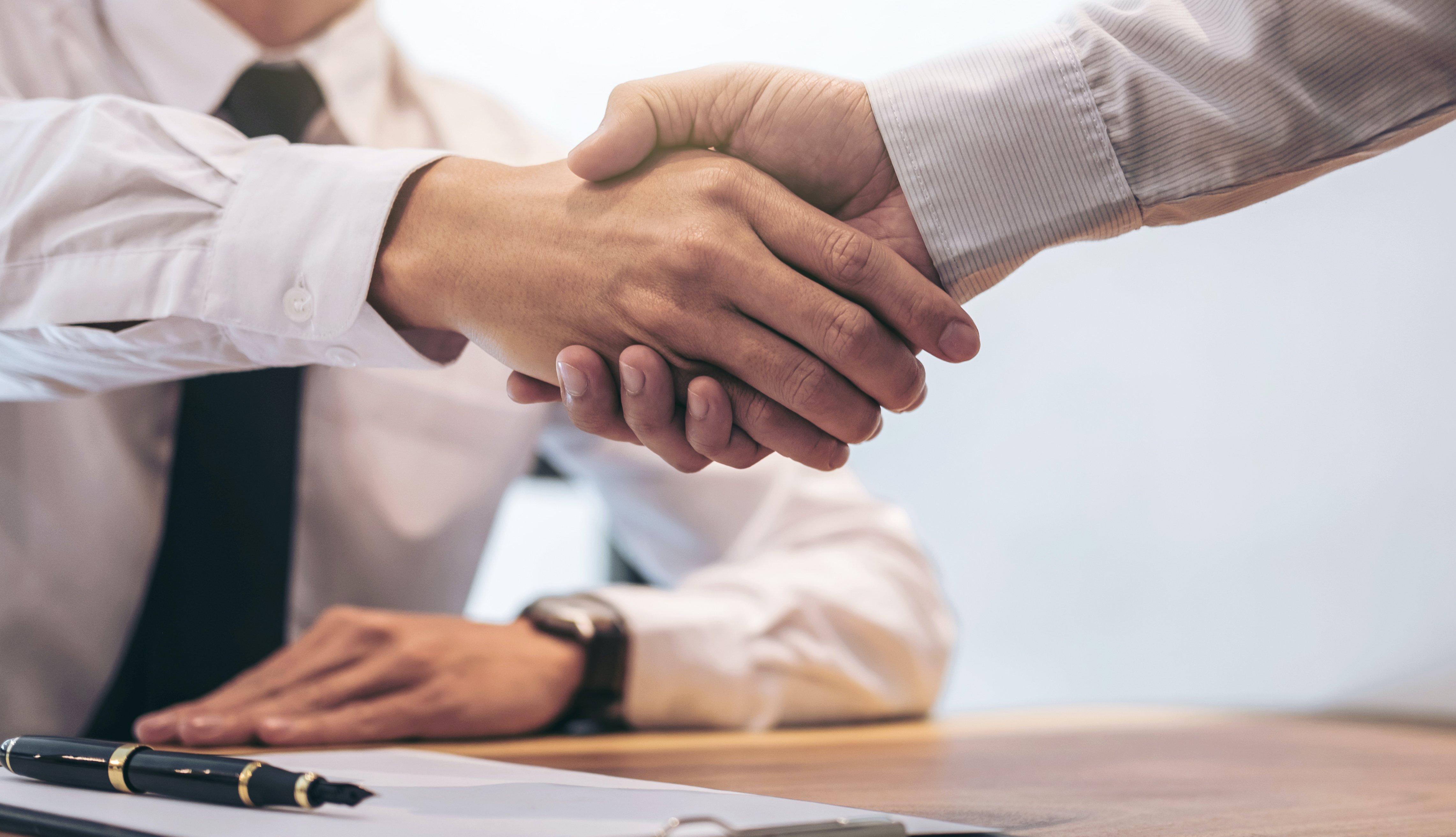 Deal-sealing handshake