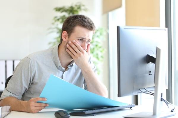 Frustrated Salesman at computer