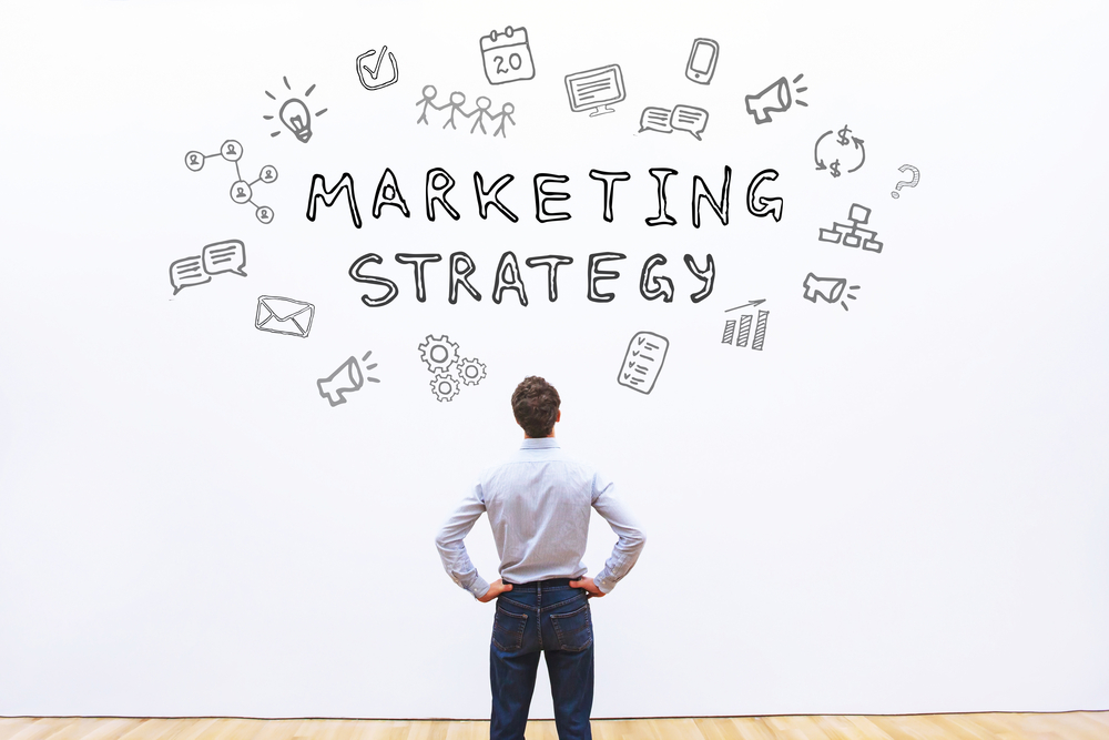 Man Looking at Marketing Strategy on Wall