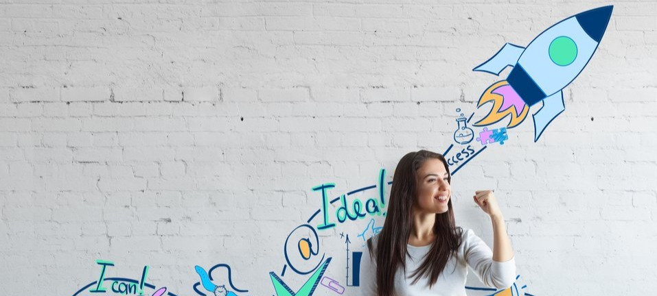 Marketer with graffiti behind her