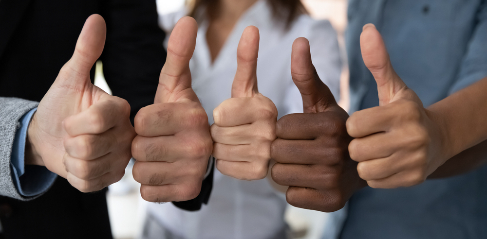 People giving a thumbs up gesture