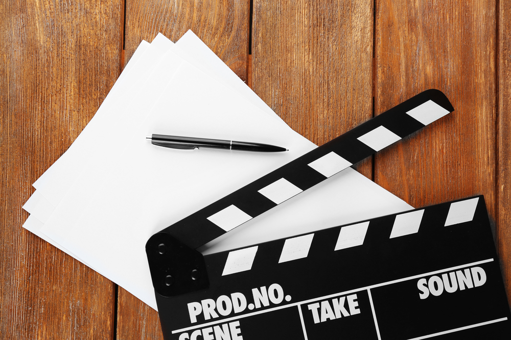 Movie script and clapboard