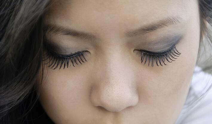 Closed eyes of young Asian-American woman with long eyelashes.jpeg