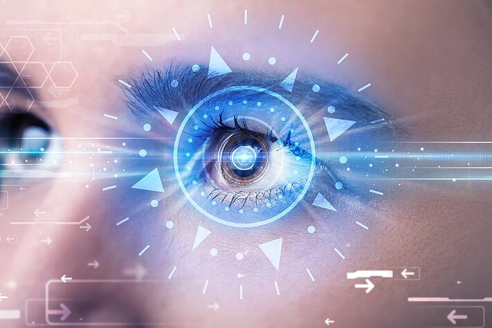 Modern cyber girl with technolgy eye looking into blue iris.jpeg