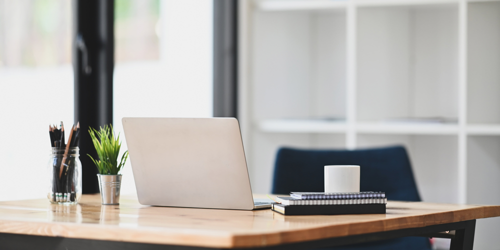 a minimalist approach decorating a desk