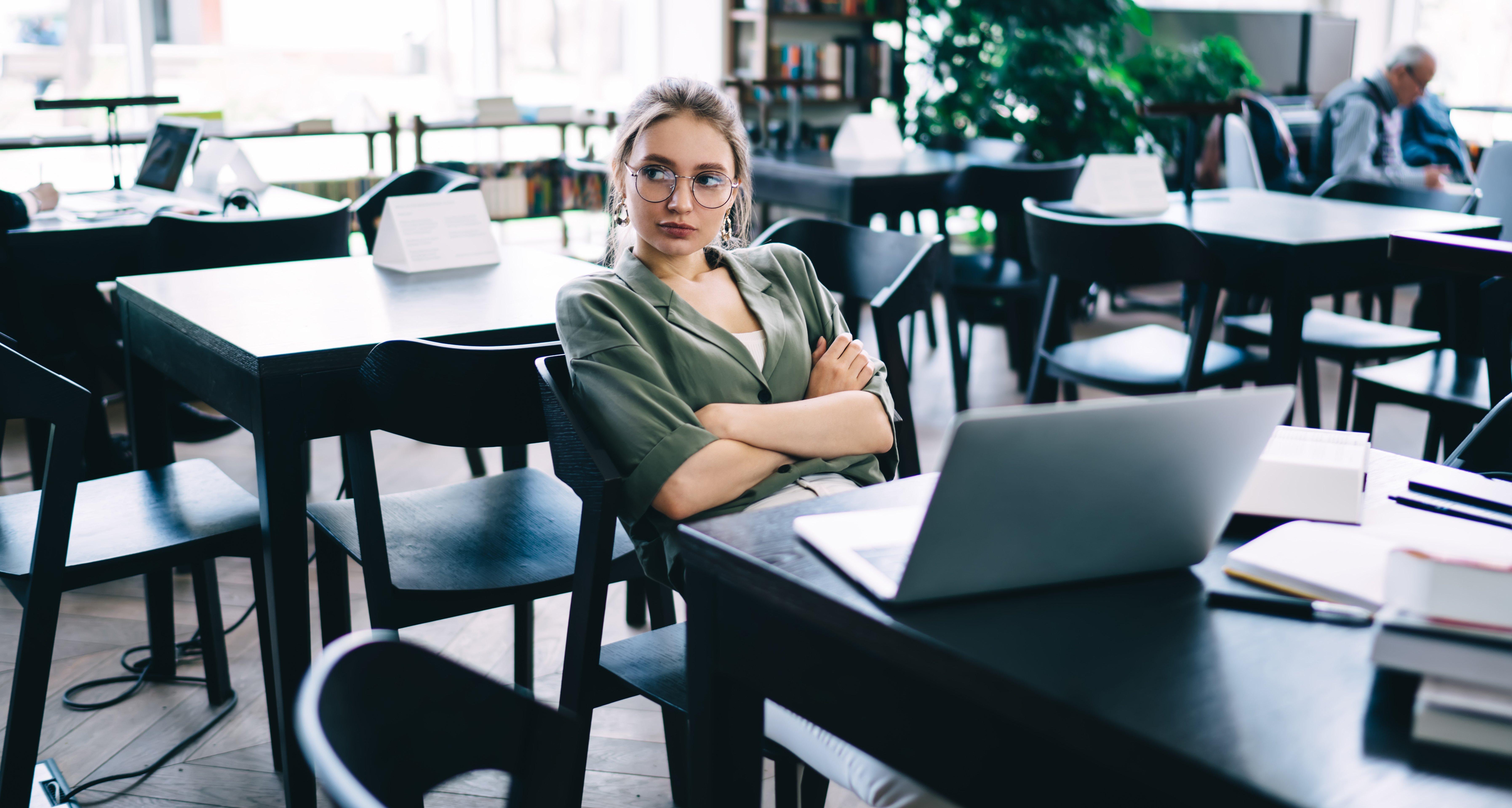 bored reader sitting in restaurant